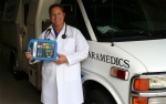 Dr. Donald Linder with the Emergency Instruction Device outside his hospital in Cedar Rapids, IA.