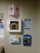 Easy to access medical-related emergency equipment including AED, first aid kit, Emergency Instruction Device (EID) and signage.