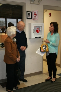 Nancy Alderdyce installing the AED with Jean and George Ross at Starry Elementary